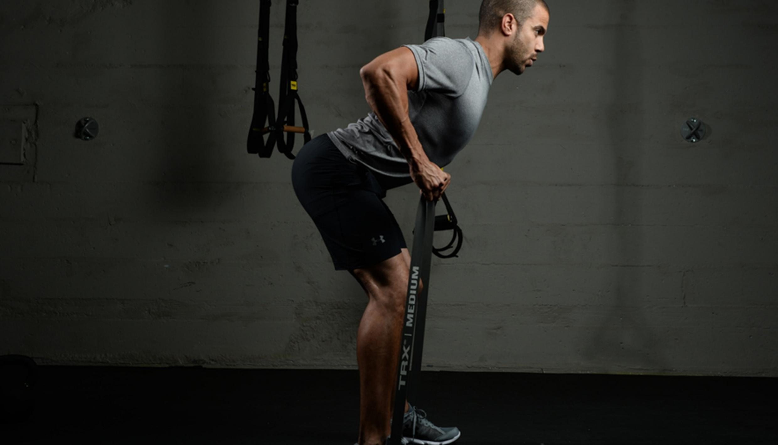 Man working out with TRX bands