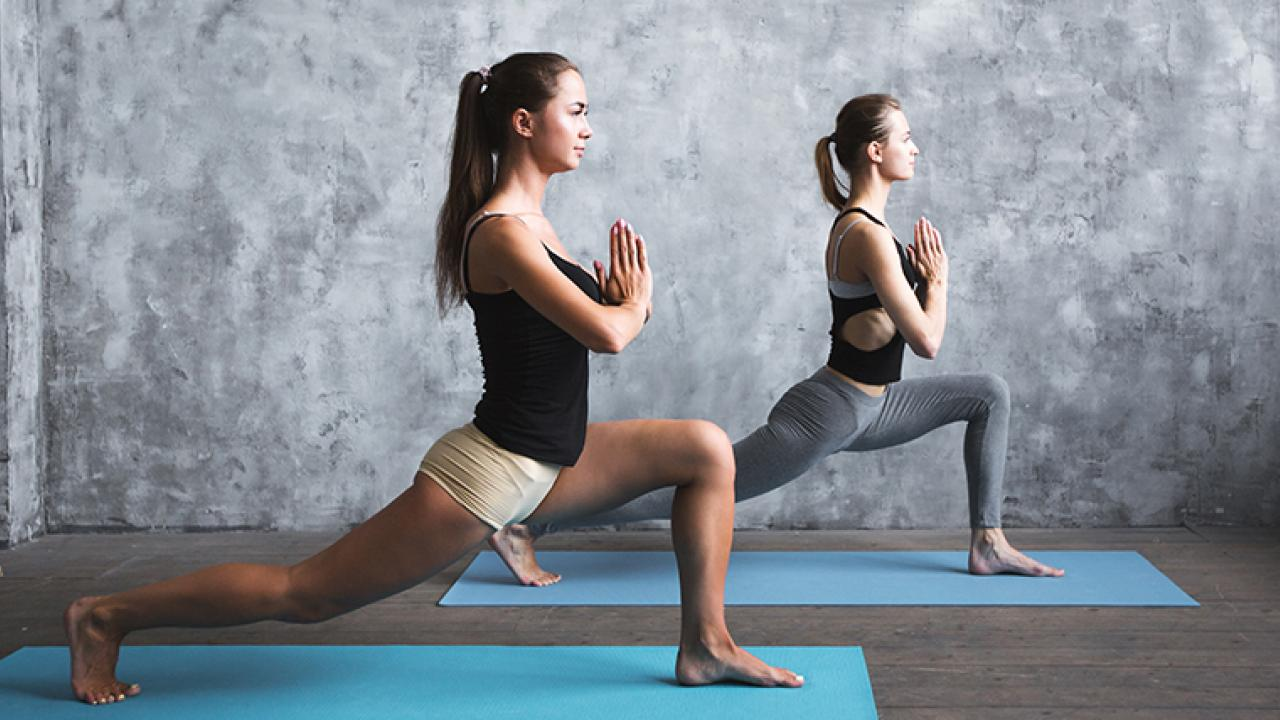 women doing yoga together in class