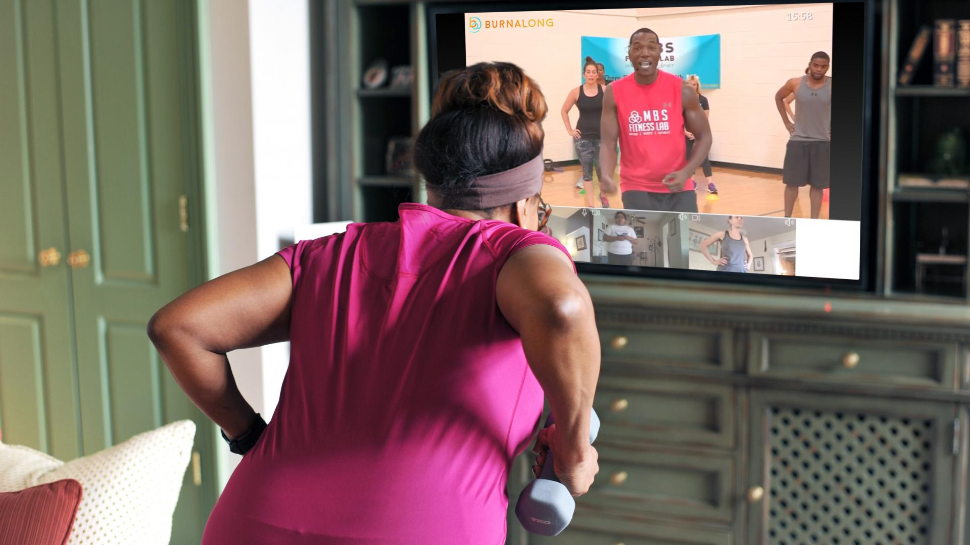 Woman doing a work out class at home
