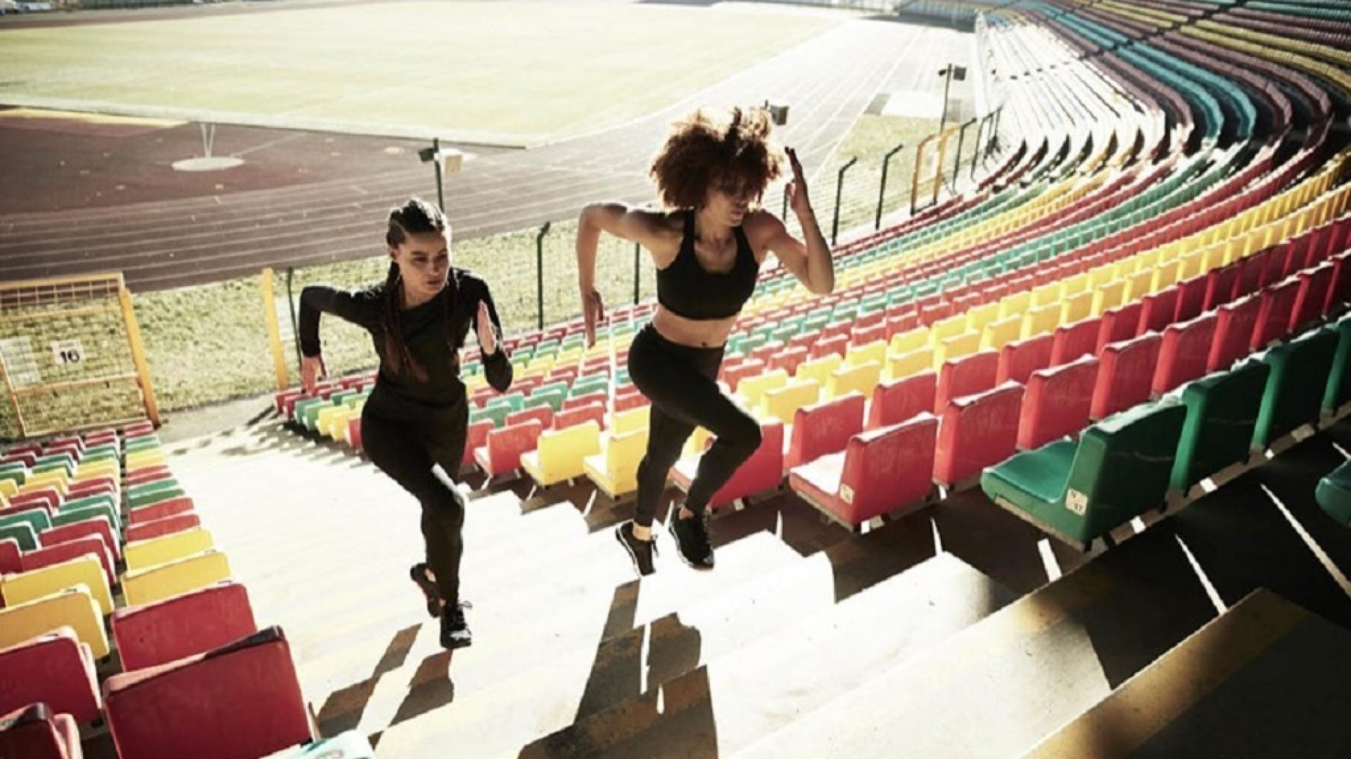 Women running up stairs in a stadium