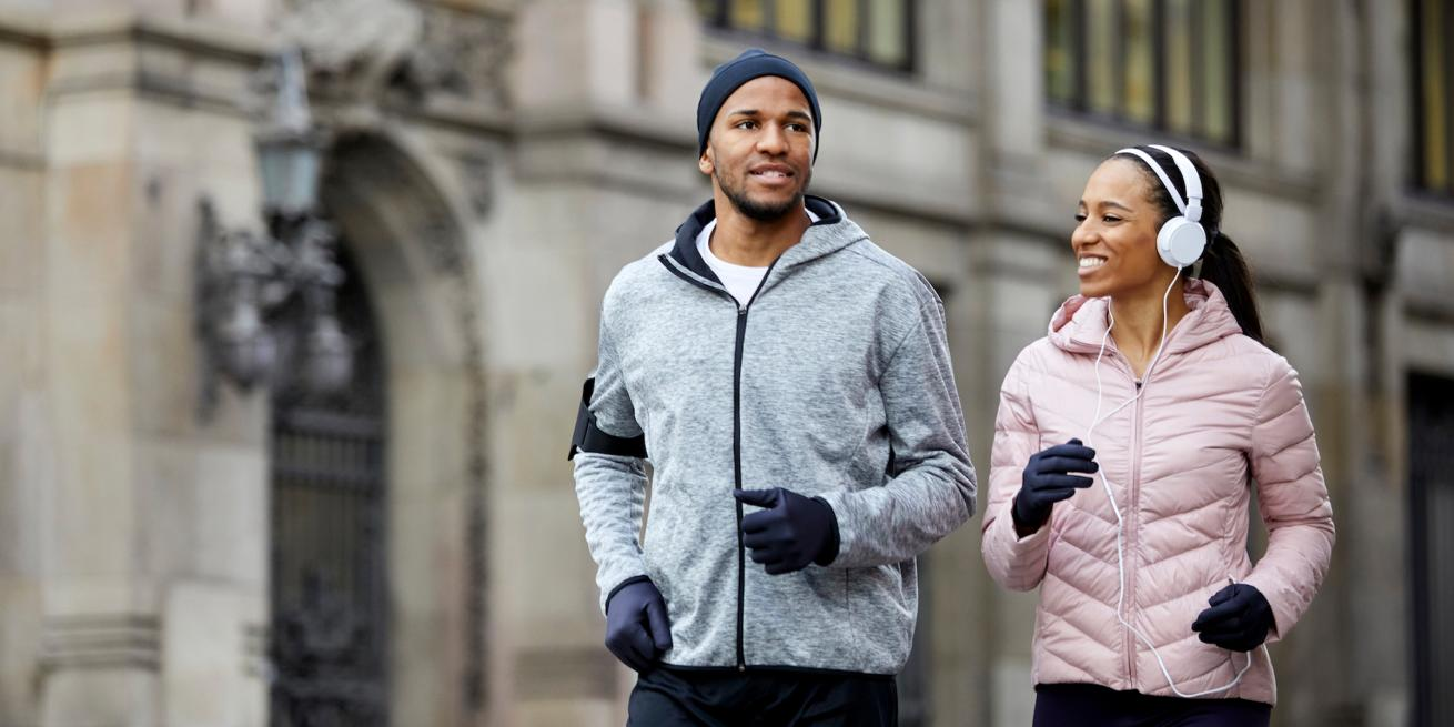A couple briskly walks in winter weather gear